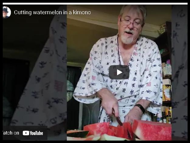 Cutting watermelon in a kimono